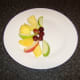 Fresh fruit of choice is arranged on a plate