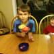 Enjoying their strawberry lemonade slush.