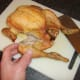 Leg and thigh portions are firstly cut from the chicken