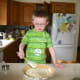 Spreading the pie filling helps develop fine motor skills, yet another way that cooking is a wonderful activity for kids!