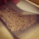 Use a second cookie sheet to help flatten the mixture.