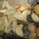 Roasting ginger, garlic and salt in oil.