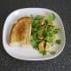 Toast is plated beside salad