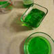 The Jell-O will look a normal green color in regular light.