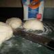 Divide the dough evenly, making four smaller balls; let it rest for five minutes.