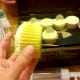 Add toothpicks to the bottom of the cupcakes to be able to secure in the top of the shoe box.