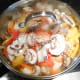 After the veggies have steamed for about five minutes add 1 cup of shredded colby-jack cheese over the top of the veggies. Cover and bring the heat down to low.