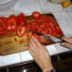 Finely chop the tomatoes.
