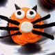 Frost the cupcakes and add the licorice and marshmallows to create the cat face.