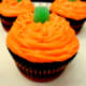Top each cupcake with a green gum drop.