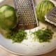 Grated lime zest is smaller, microplaned lime zest is thinner and longer.