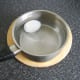 Peeled duck egg is submerged in cold water to cool quickly