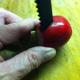Insert the tool into the radish and push half way through.