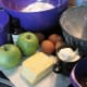 Ingredients for the apple bundt cake, and the floured bundt tin.