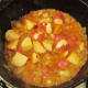 Adding the Potatoes to the Pot Roast Stock.
