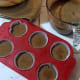 7. With the help of a measuring cup, pour cake batter into lined cupcake tins.