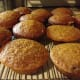 Freshly baked pumpkin muffins cooling on the rack.