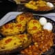 Stuffed potato Jackets with potato cheese and onion sauce served with hardboiled egg and baked beans