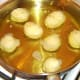 Peeled potatoes are added to hot oil