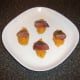 Pigeon breast halves are laid on sweet potato quenelles