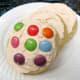 Decorate sugar cookies with brightly colored candies or sprinkles.