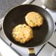 Spicy salmon and sweet potato cakes are shallow fried in oil