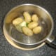 Butter and chives are added to drained new potatoes