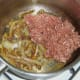 Mince is added to sauteed onion and spices