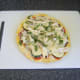 Basil garnishes pizza omelette for service