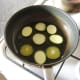 Frying courgette and aubergine slices