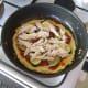 Chicken tops vegetables on pizza omelette