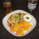 Corona beer is served with spicy chicken pizza omelette