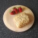 Strawberries and honey and sunflower seed bread roll