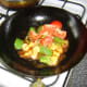 Tomato is added to the Kung Po chicken at the very end of the cooking process
