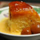 Steamed Cumquat Marmalade Pudding served with Warm Custard Sauce and Brandied Cumquats. Image: © Siu Ling Hui