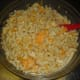 Once the macaroni has finished cooking, drain thoroughly and mix into the cheese mixture.