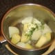 Butter and chives added to drained potato and trunip