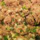 Ground turkey mixture is prepared carefully to form meatballs that will be tender, juicy, and flavorful.
