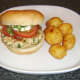 Spicy chicken burger and roast potatoes is ready to eat.