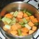Chopped celery and sweet potato added to turkey stock