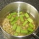 Celery and cannellini beans added to turkey stock