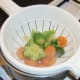 Draining boiled vegetables