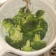 Broccoli florets are washed before being cooked