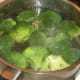 Broccoli is simmered in boiling salted water