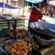 Street vendors selling banana fritters. He uses the pisang abu.