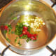 Frying off spices for bean chilli