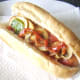 Stir fried peppers and mushrooms on hot dog