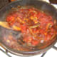 Tomatoes are stirred through spicy onions and mushrooms