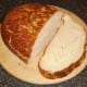 Thick slice of bread is cut for toasting.