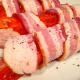 Wrap the fresh salmon fillet with bacon and secure the bacon with a toothpick.